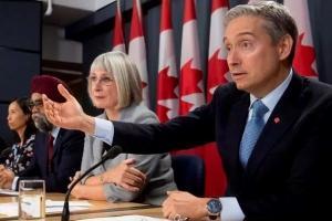 加拿大终于宣布撤侨:持有枫叶卡的华人可以一起走